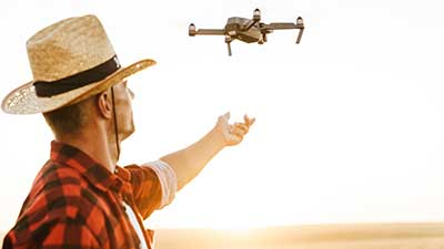 image-of-focused-handsome-man-using-drone-while-st-82WLPBY
